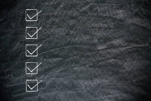 checklist on blackboard background textured - checklist stock photos and pictures
