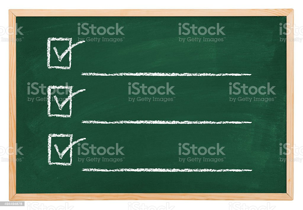 Checklist on blackboard stock photo