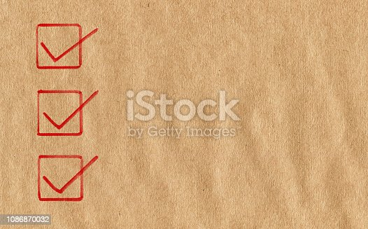 Checklist on brown paper background