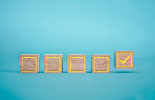 istock Checklist on the Blue Background with Wooden Block 1182026336