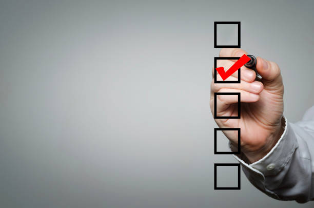 Checklist Blank checklist on the whiteboard with businessman hand drawing a red check mark in the check box checklist stock pictures, royalty-free photos & images