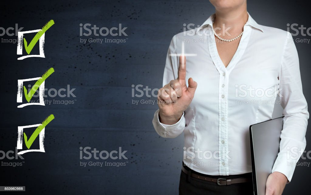 Checklist touchscreen is shown by businesswoman stock photo