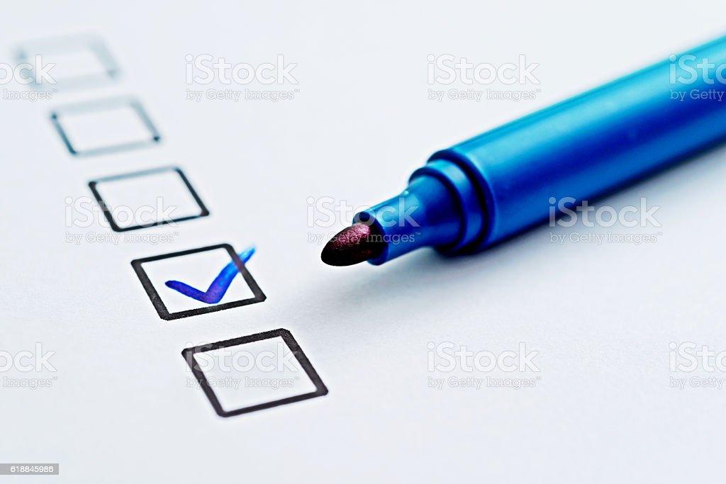 Checklist with check mark stock photo