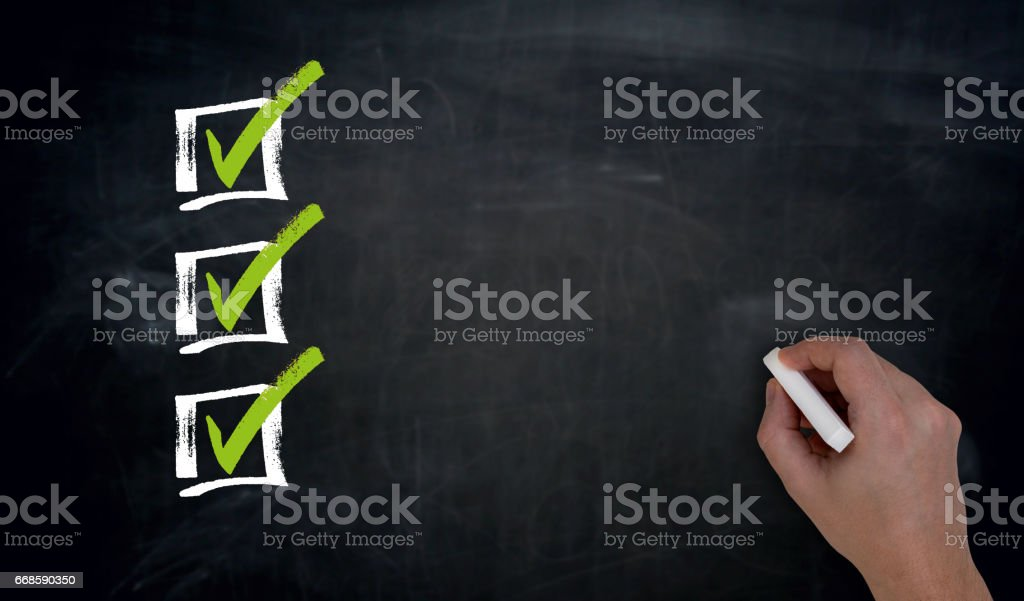 Checklist with Copyspace Hand writing on blackboard stock photo