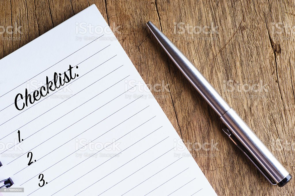 'Checklist' words on notebook stock photo