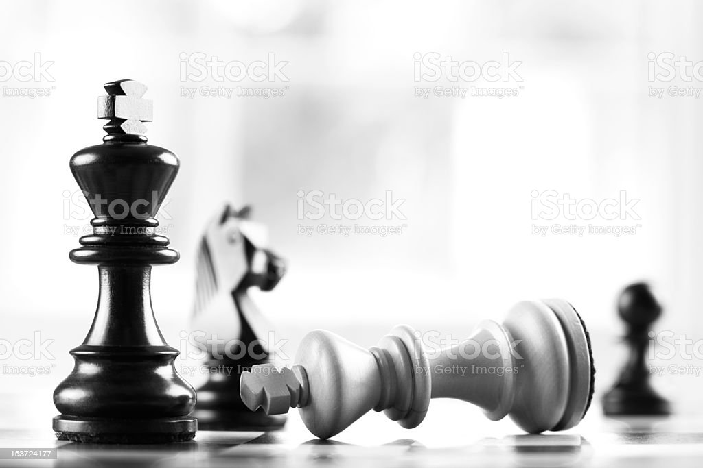 checkmate black defeats white king stock photo