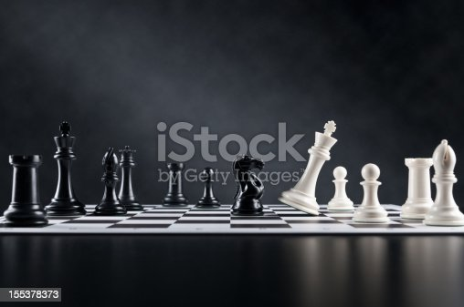 Checkmate move, Chess Knight is checking Chess King on chess board.