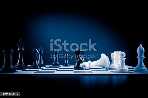 King checkmate on chessboard in blue colour, white king defeated.