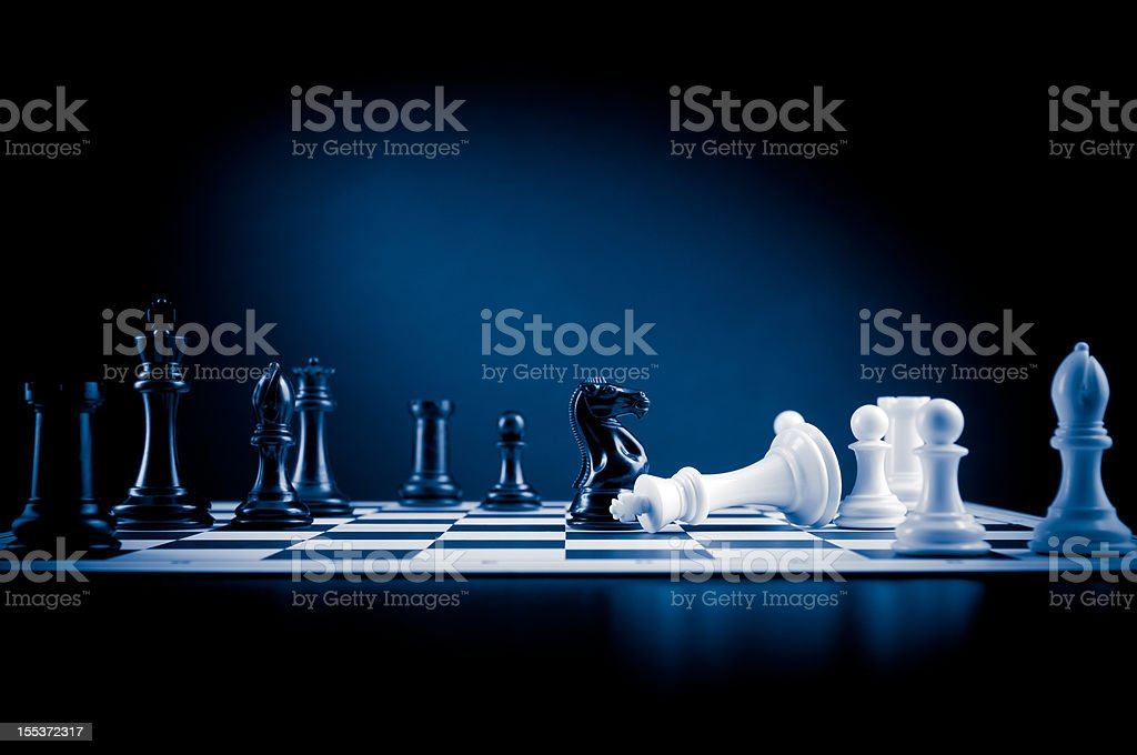Checkmate move on chessboard in blue, white king defeated stock photo