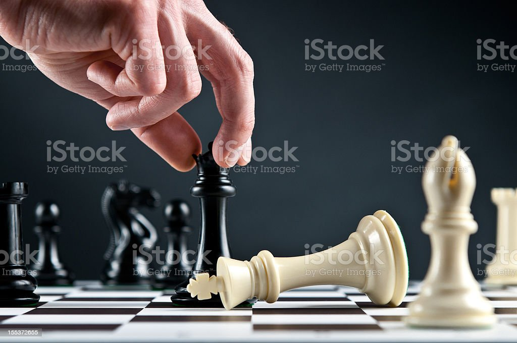 Checkmate Strategy on chessboard, white king defeated royalty-free stock photo