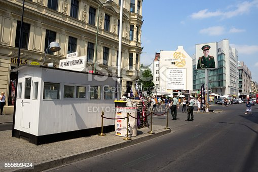BERLIN, GERMANY - MAY 23, 2014: Tourists around the former Allied Checkpoint Charlie. Nowadays this site is a tourist attraction.