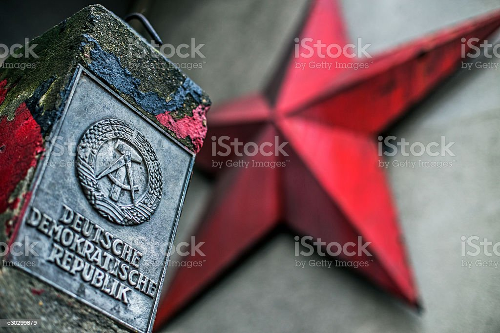 BERLIN - Checkpoint Charlie - GDR vintage red star stock photo