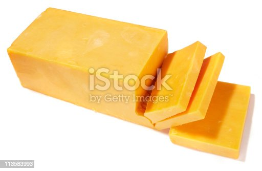 A block of sliced cheddar cheese isolated on white