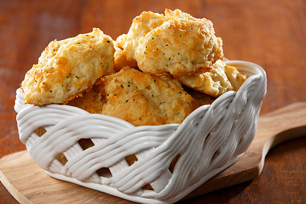 Cheddar Cheese Biscuits Basket full of cheddar cheese biscuits biscuit stock pictures, royalty-free photos & images