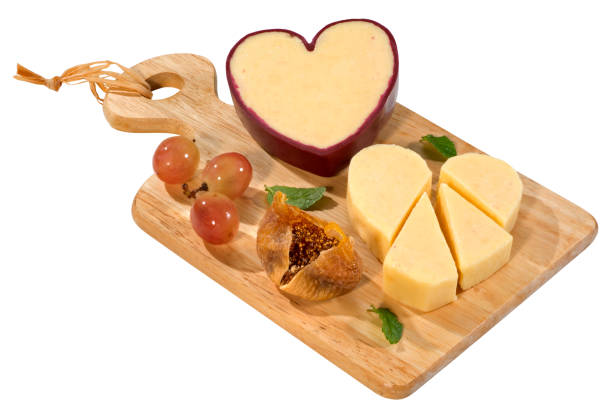 Cheddar Cheese in heart shape stock photo