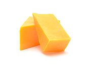 istock cheddar cheese isolated on white background 672526668