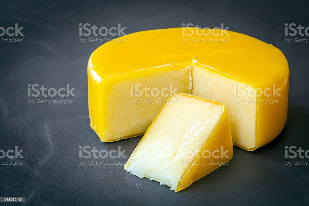 Cheddar Cheese on Black Slate stock photo