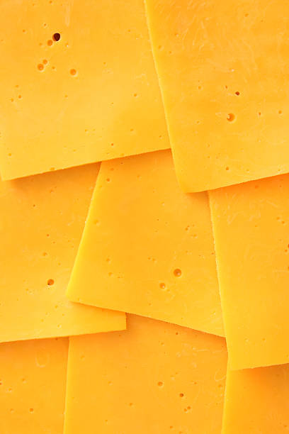 Cheddar slices Top view of cheddar cheese slices cheddar cheese stock pictures, royalty-free photos & images