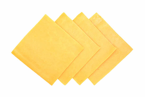 cheddar slices stock photo