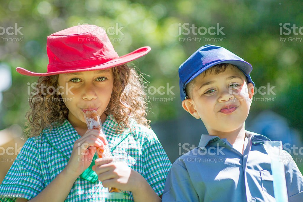 Cheeky children and ice pops stock photo