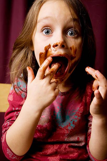 cheeky schokolade mädchen - kinderschokolade stock-fotos und bilder