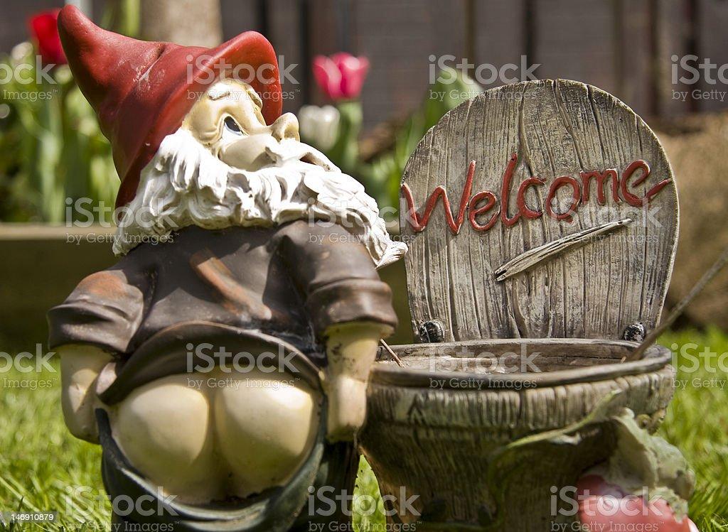 cheeky garden gnome, welcome stock photo