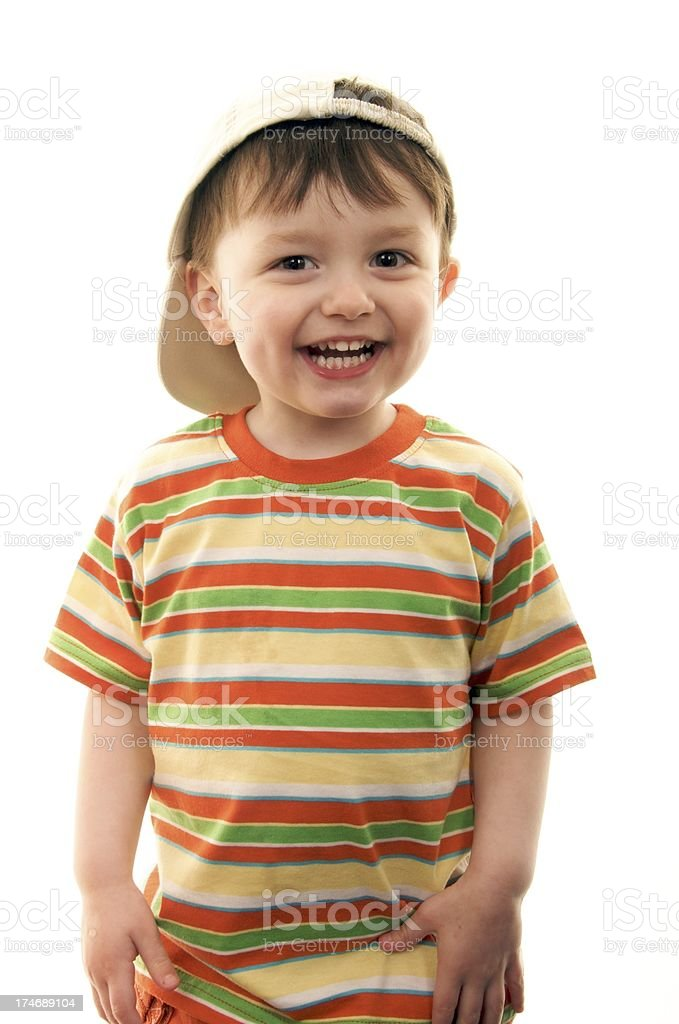 Cheeky little boy with a colorful striped shirt and a hat royalty-free stock photo