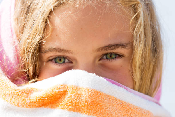 Cheeky Young Girl Wrapped In Towel stock photo