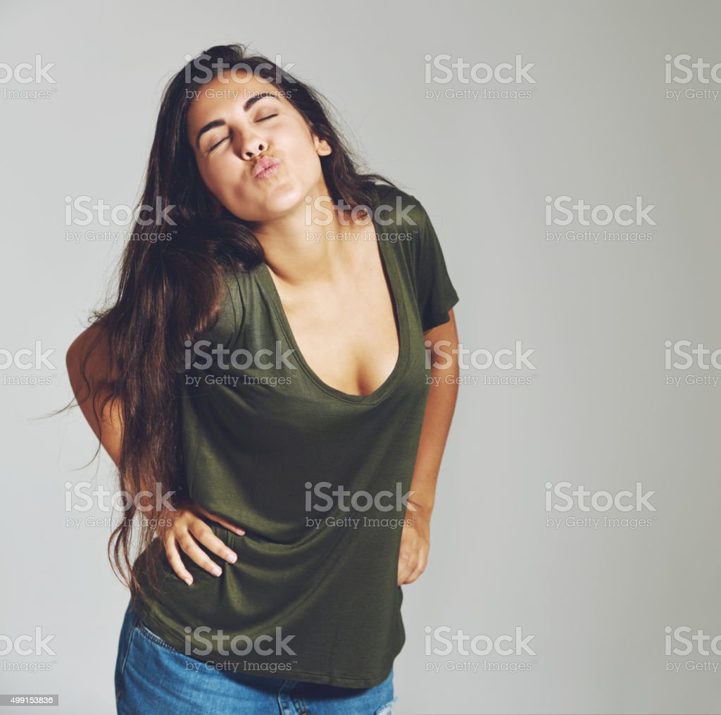 Cheeky young woman flirting with the camera stock photo