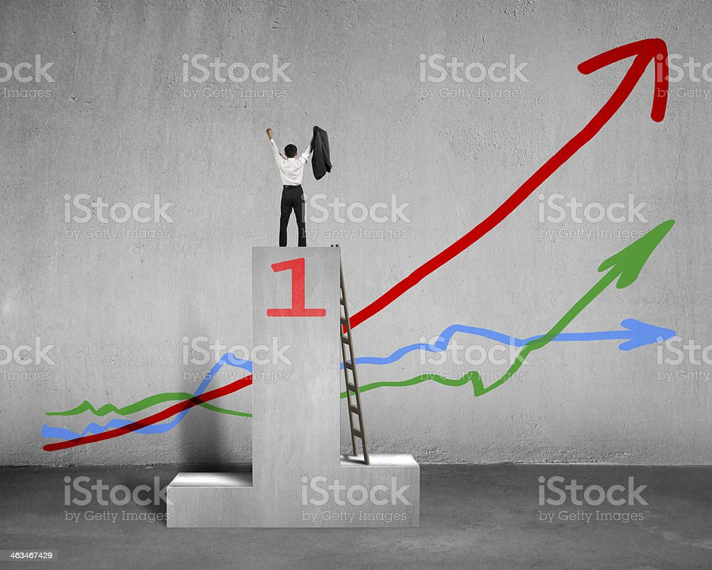 Cheered businessman standing on podium with 3 trends royalty-free stock photo