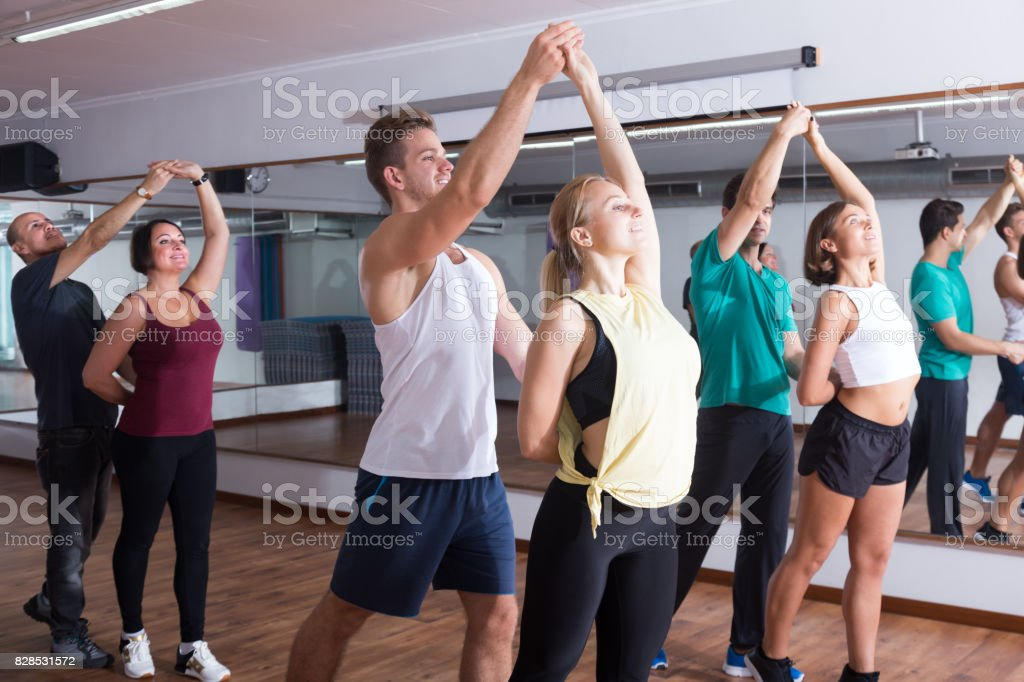 Cheerful adults dancing bachata together stock photo