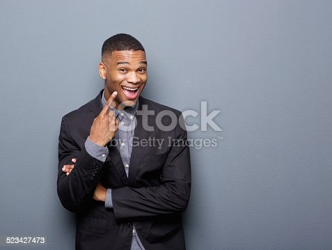 825083570 istock photo Cheerful african american business man pointing finger 523427473