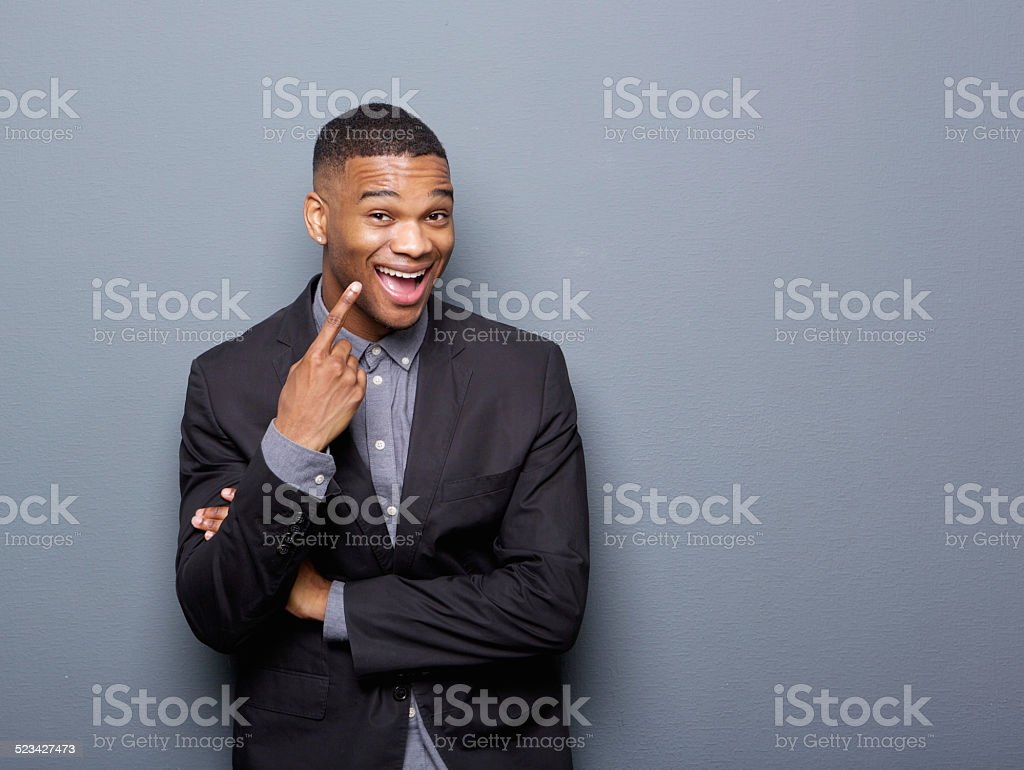 Cheerful african american business man pointing finger stock photo