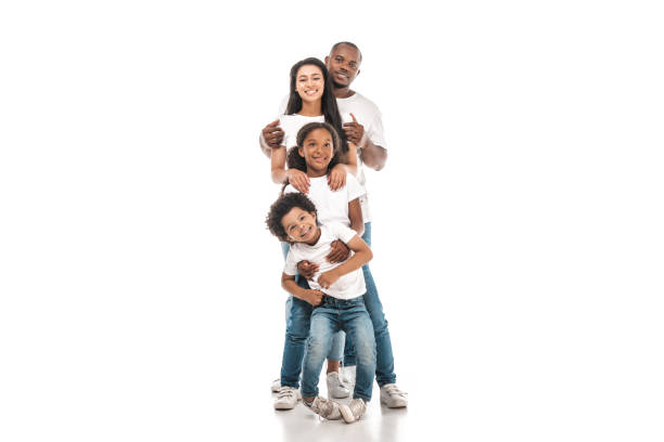 cheerful african american family standing one behind other and smiling at camera on white background - białe tło zdjęcia i obrazy z banku zdjęć