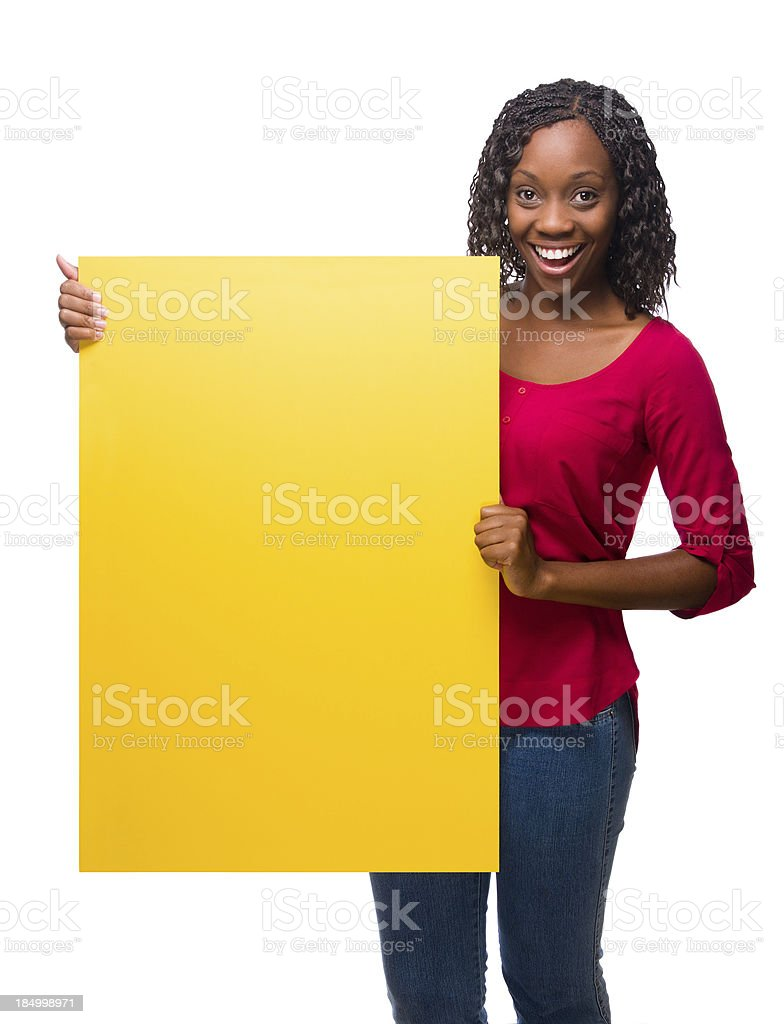 Cheerful african american woman holding a sign royalty-free stock photo
