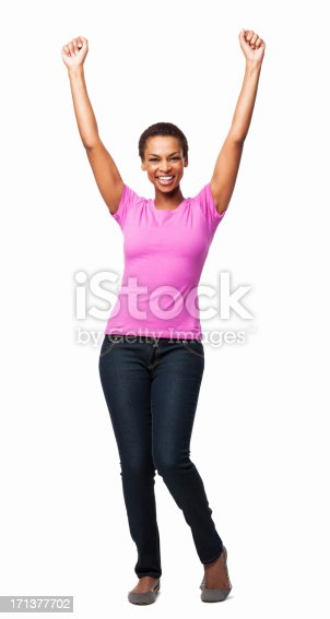 Full length portrait of a cheerful African American woman celebrating success with her arms raised. Vertical shot. Isolated on white.