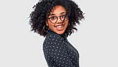 istock Cheerful African American woman smiling and spinning with her healthy hair, feeling happy, posing over white wall. Beautiful Afro female smiles broadly with healthy white teeth and blowing hair 1162554233