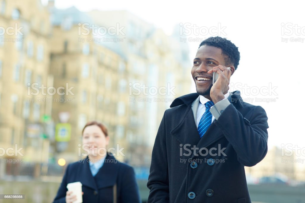 Cheerful African Businessman Making Phone call foto stock royalty-free