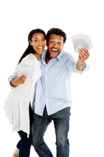 istock Cheerful african couple holding lots of money 453963183