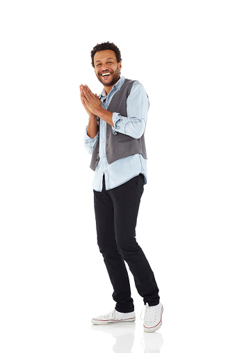 Full length image of cheerful african man standing over white background