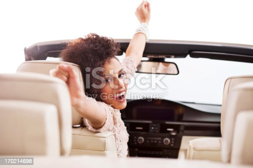 istock Cheerful African-American woman in convertible car. 170214698