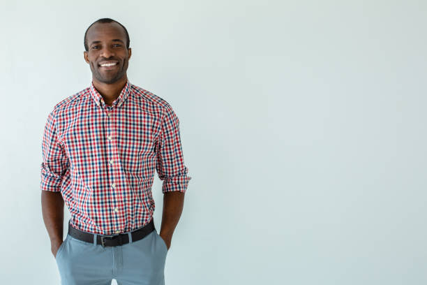 Cheerful afro american man smiling against white background stock photo