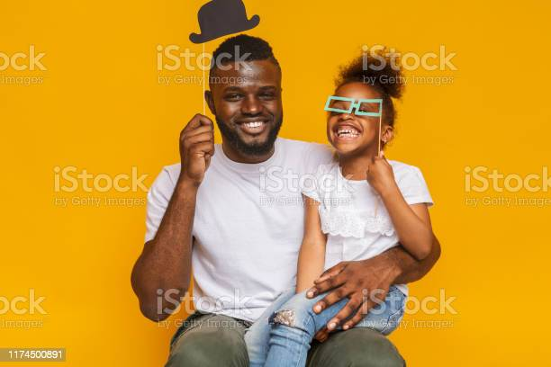Cheerful afro father and daughter posing with photo props picture id1174500891?b=1&k=6&m=1174500891&s=612x612&h=0viyxkknt ue sbvtyw7db3hcp rg8yq8 nxlzundoy=