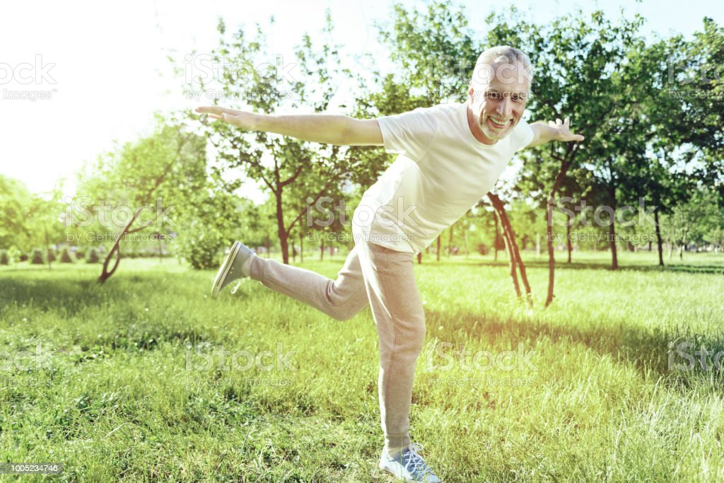Cheerful Aged Man Enjoying Funny Exercises Stock Photo Download Image Now Istock