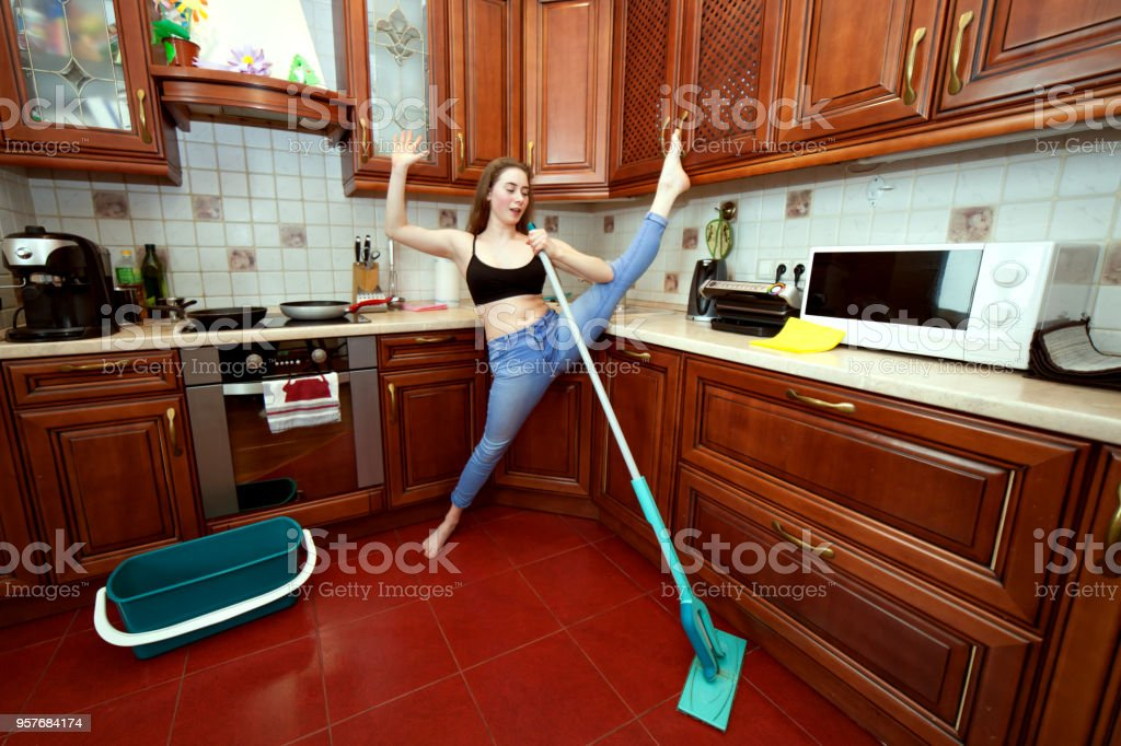 Cheerful apartment cleaner. stock photo