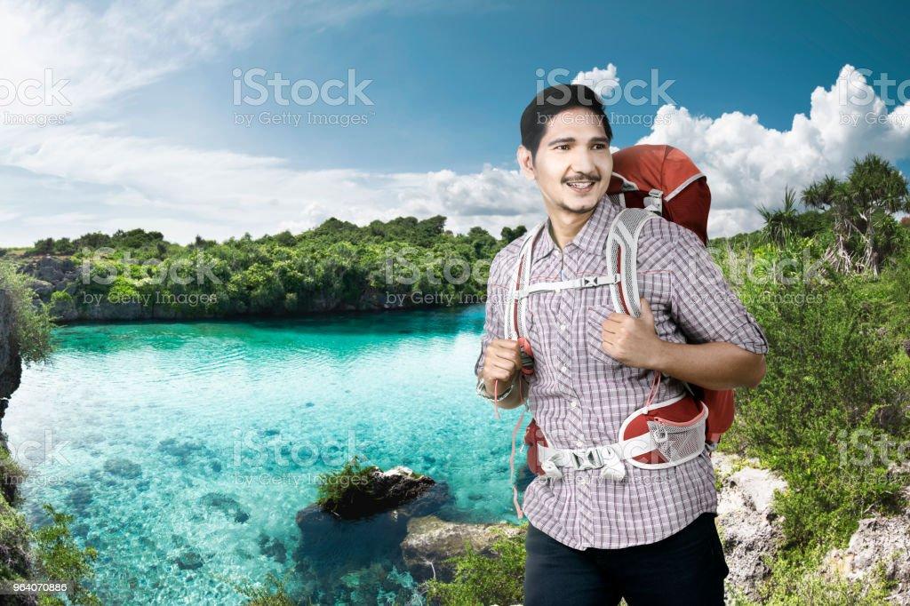 Cheerful asian backpacker enjoying nature - Royalty-free Adult Stock Photo