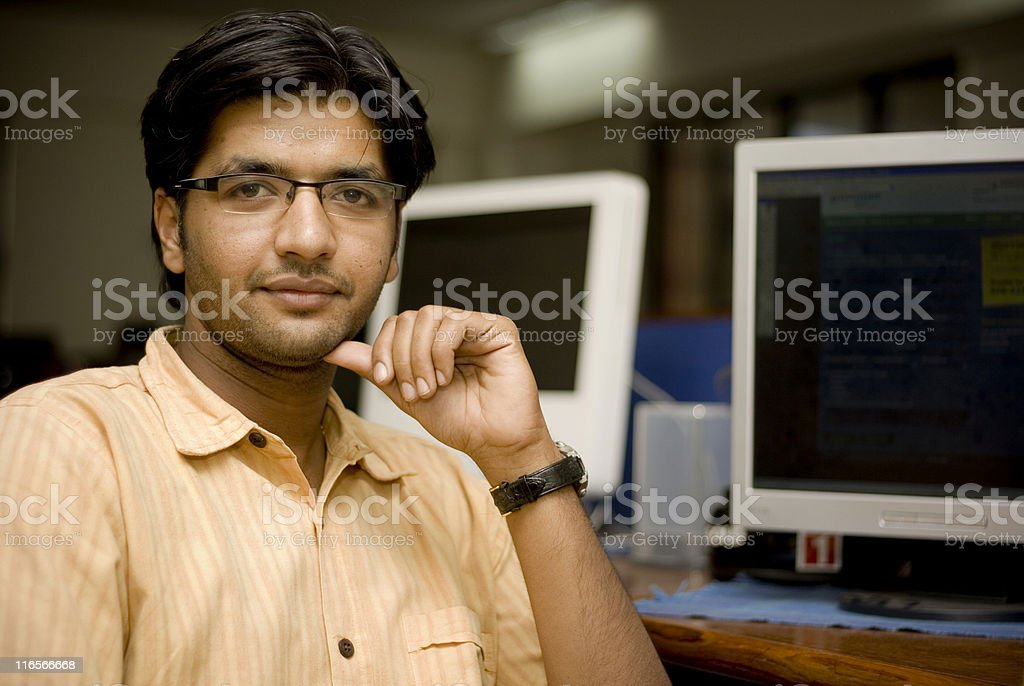 Cheerful Asian Indian man IT office worker employee stock photo