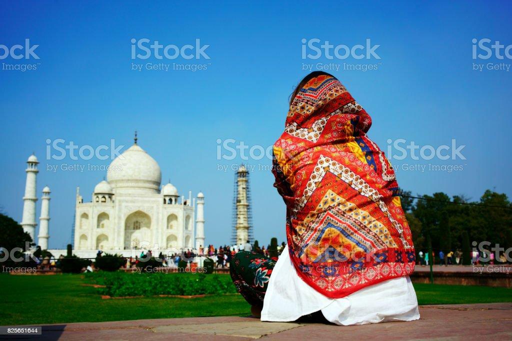 Cheerful Asian woman with Taj Mahal background stock photo