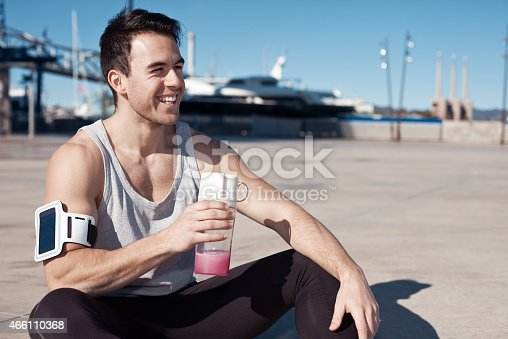 852024650istockphoto Cheerful athlete with protein cocktail 466110368