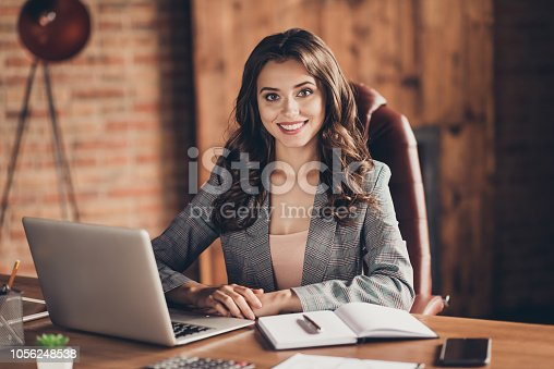 istock Cheerful attractive adorable stylish beautiful classic trendy business lady sitting in front of laptop at work place, station 1056248538